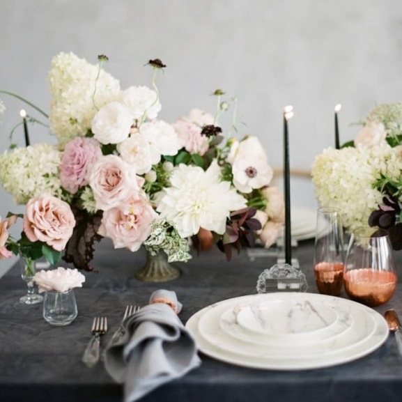 Candles and flowers blend perfectly into this elegant wedding table setting!
